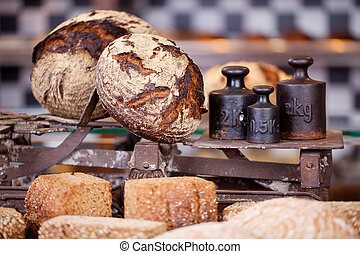 Bread loaves and weights in the bakery