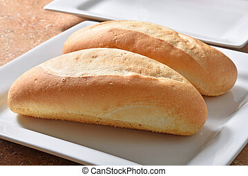 Bread loaves - Golden loaves of bread on a plate