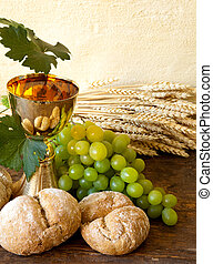 Bread of Jesus - Grapes and holy bread next to a golden...