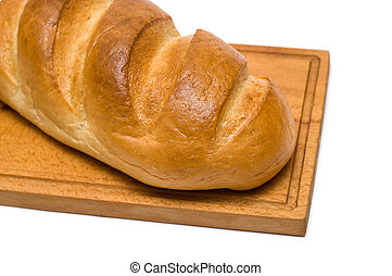 bread on breadboard isolated on white background