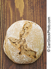 bread on brown wooden background