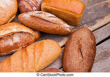 Bread on rustic wooden background.