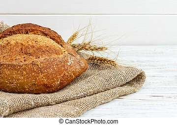 bread on the table, homemade bread with wheat on a wooden background
