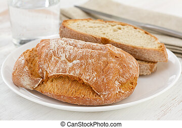 bread on the white plate