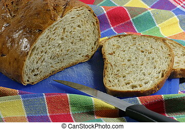Bread with kitchen cloth and knife