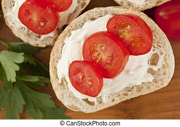 bread slice with butter and tomato