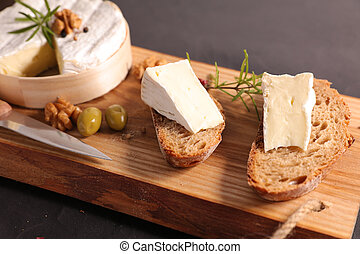 bread slice with camembert on wooden board