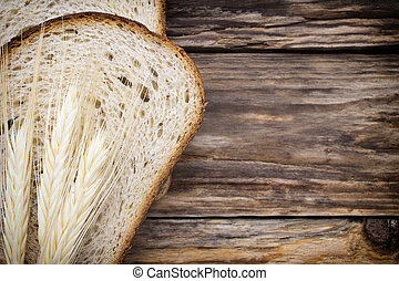Bread. - Slices of bread on a wooden background.
