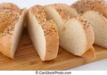 Bread slices on board close up.