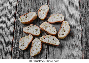 Bread Slices on Wooden Background