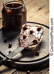 Bread spread with chocolate butter from jar