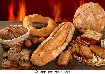 Bread still life with varied shapes and bakery fire in ...