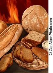 Bread still life with varied shapes and bakery fire in...