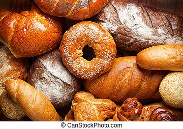bread, surtido, en, tabla de madera, plano de fondo
