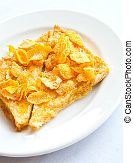 Bread topped with honey on a white dish