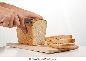 bread with a knife on a cutting board