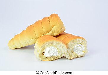 Bread with cream spiral on white background