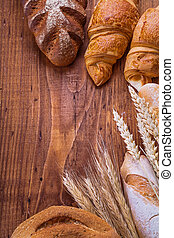 bread with ears on wooden background food and drink still life