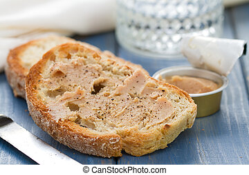 bread with fish pate on blue wooden background