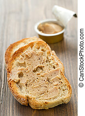 bread with fish pate on brown wooden background