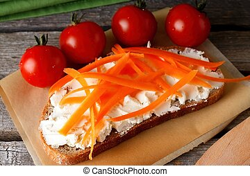 Bread with fresh cheese and few tomatoes