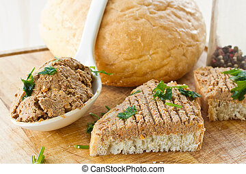 bread with homemade liver pate and herbs