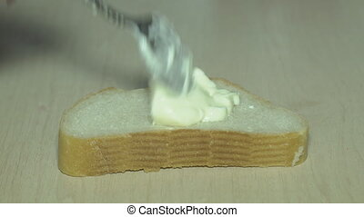 Bread with mayonnaise - A cook in the kitchen spreads butter...