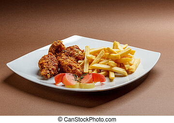 Breaded chicken wings  with french fries