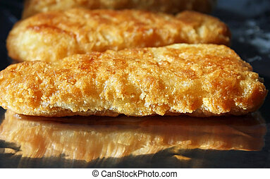 Breaded Fish - Breaded fish portions cooking on foil in the...