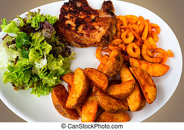 Breaded grilled meat, potatoes and vegetables