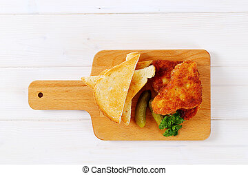 breaded schnitzels with toast