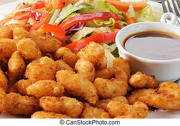 Breaded shrimp and salad close up - Macro of a pate of...