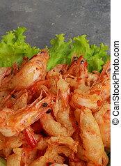 Breaded shrimp on the lettuce