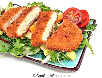 breaded steak sliced %u200B%u200Bover a salad of arugula