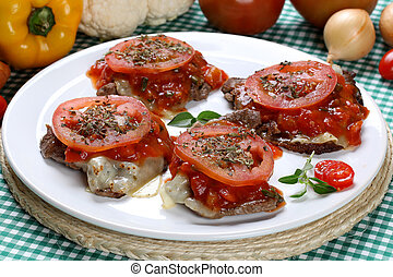 Breaded steaks with cheeses and tomato sauce .