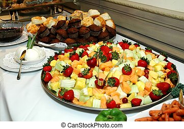 Breads and Fruits - Assorted breads and fruits on buffet ...