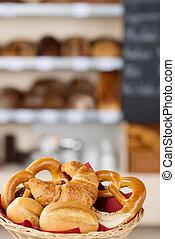 Breads In Bread Basket On Bakery Counter