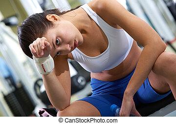 Break after training - Portrait of tired brunette having...