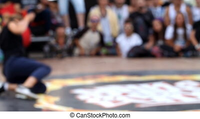 Break dance competition at the festival, blurred background,...