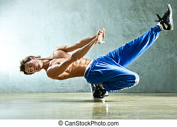 Break dance - Young strong man break dance.