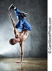 Young strong man break dance.