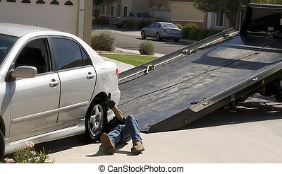 Break down truck picking up car