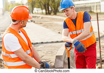 Break during job - Construcion workers have a break in their...