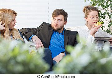 Break form work - Coworkers having a break form work siting ...