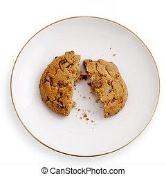 Break oatmeal cookies on a saucer