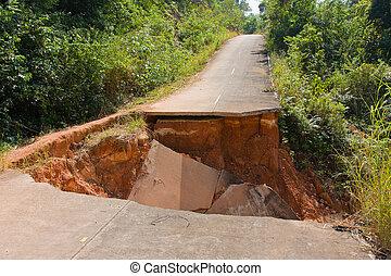 Break of asphalt road in island koh Chang, Thailand