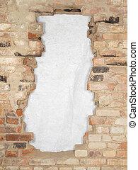 Break the old brick wall consisting of a variety of bricks.