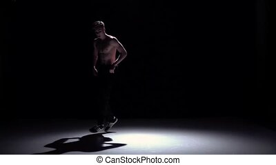 Breakdance blonde man dancing breakdance on black, shadow, slow motion