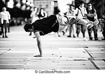 Breakdancer showing off on the streets in Wroclaw, Poland