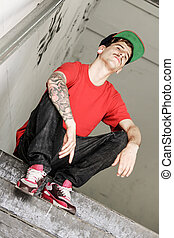 Breakdancer sitting - A cool hip-hop dancer chilling in the...